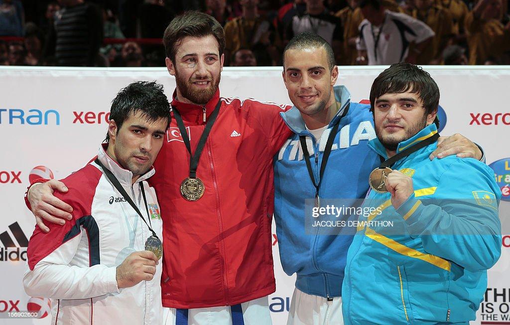 Azerbaidjian's silver medalist Shahin Atamov, Turkey's gold medalist Enes Erkan, Italy's bronze medalist Stefano Maniscalco and Kazakhstan's bronze medalist Khalid Khalidov pose on the podium of the Male Kumite over 84kg category at the Karate world championships on November 24, 2012 in Paris.