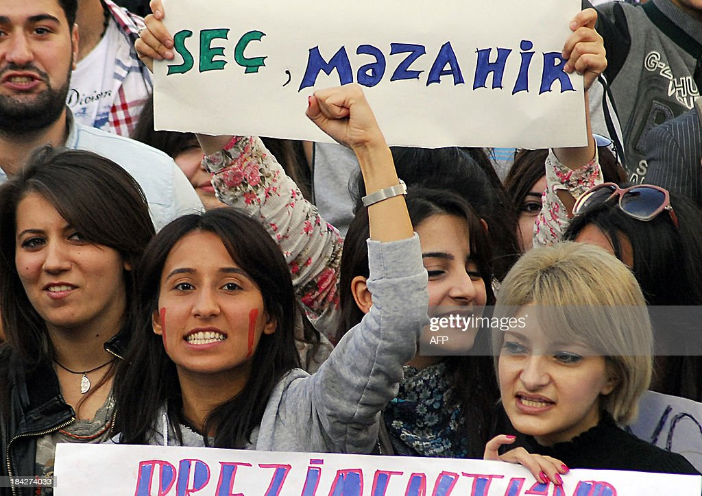 Azerbaijan opposition activists rally in Baku on October 12, 2013. Some 6,000 opposition supporters rallied yesterday in Baku to protest strongman Ilham Aliyev's crushing victory in an election that observers said fell short of international standards.