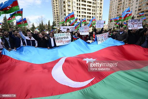 Azerbaijan opposition supporters take part in rally with the slogan 'No to spendthrift and lye' in Baku on April 5 2015 AFP PHOTO / TOFIK BABAYEV