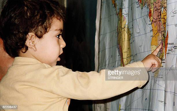 TO GO WITH AFP STORY 'At two Azeri toddler has found his way in the world' This picture dated 27 January 2005 shows 2yearold Ayhan Abdullayev looking...