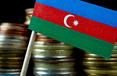 Azerbaijani flag waving with stack of money coins macro