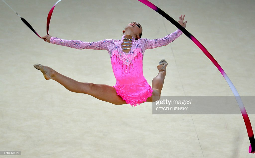 Azerbaijani Marina Durunda performs during the ribbon program of the individual all-around final of 32nd Rhythmic Gymnastics World Championship in Kiev on August 29, 2013. AFP PHOTO/SERGEI SUPINSKY