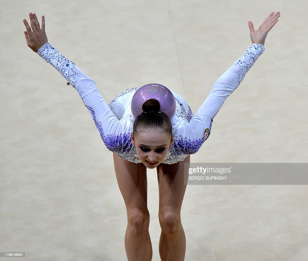 Azerbaijani Marina Durunda performs her ball program in the individual all-around final of 32nd Rhythmic Gymnastics World Championship in Kiev on August 30, 2013. AFP PHOTO/SERGEI SUPINSKY
