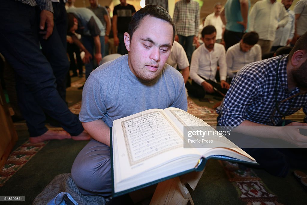 Azerbaijani Muslim reads the holy Quran while observing Qadr night (Night of Power) during Ramadan, in Baku, Azerbaijan.