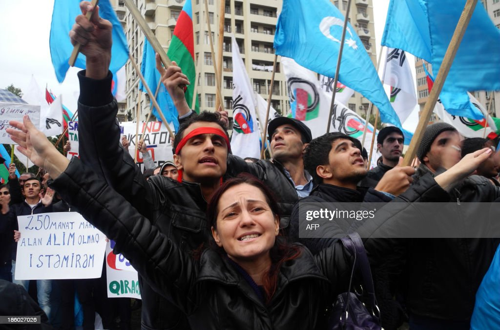 Azerbaijani opposition supporters demonstrate in Baku, on October 27, 2013. Azerbaijani President Ilham Aliyev was sworn in for a third term on October 19, 2013 after romping to victory in a widely criticised election in the oil-rich ex-Soviet country.
