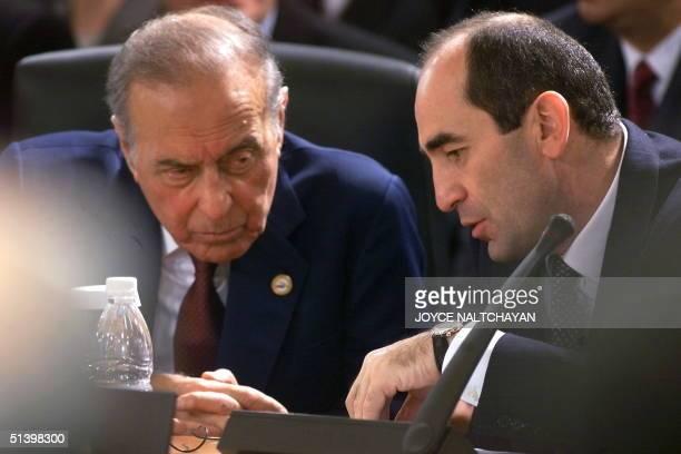 Azerbaijani President Haydar Aliyev listens to his Armenian counterpart Robert Kocharian at the conference table at the Ciragan Palace in Istanbul 18...