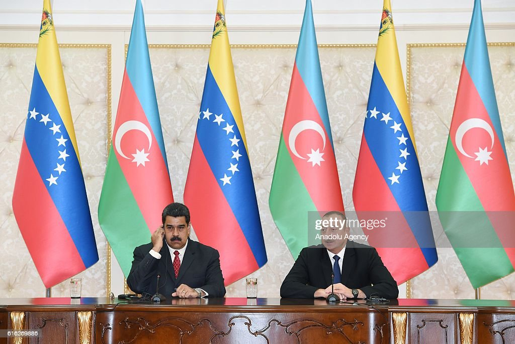 Azerbaijani President Ilham Aliyev (R) and Venezuelan President Nicolas Maduro (L) are seen a signing ceremony of a protocol during their meeting in Baku, Azerbaijan on October 22, 2016.