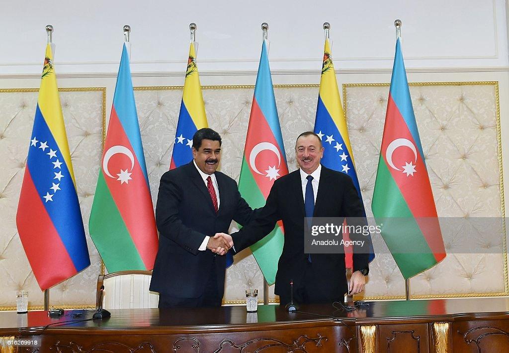 Azerbaijani President Ilham Aliyev (R) and Venezuelan President Nicolas Maduro (L) shake hands during a signing ceremony of a protocol in Baku, Azerbaijan on October 22, 2016.