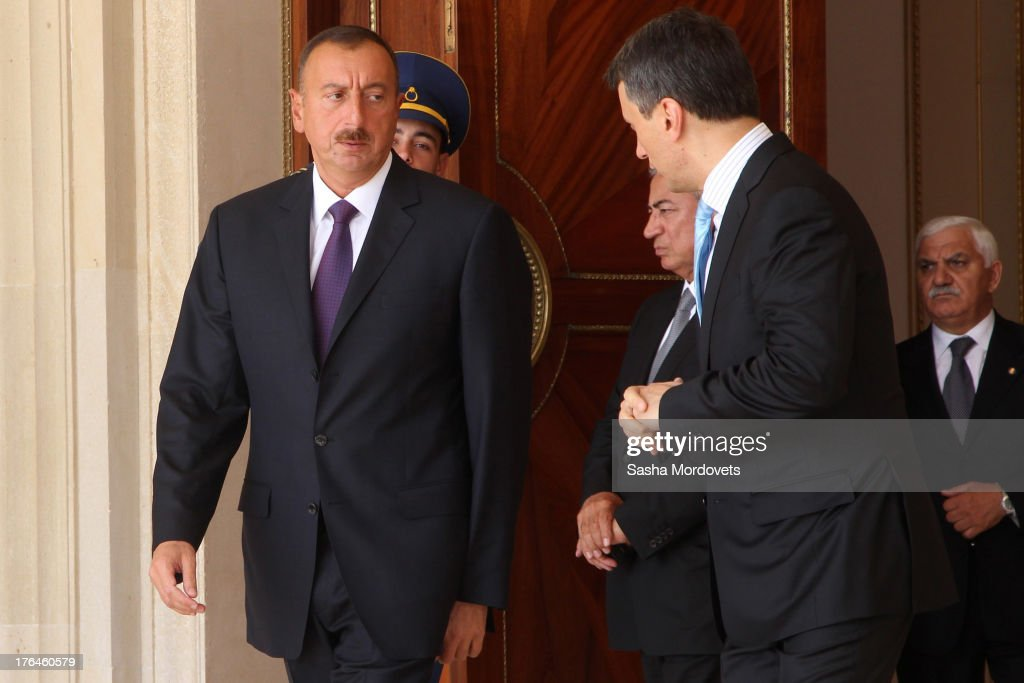 Azerbaijani President <a gi-track='captionPersonalityLinkClicked' href=/galleries/search?phrase=Ilham+Aliyev&family=editorial&specificpeople=565601 ng-click='$event.stopPropagation()'>Ilham Aliyev</a> (L) greets Russian President Vladimir Putin (not seen) at the Presidential Residence August 13, 2013 in Baku, Azerbaijan. Putin is in Azerbaijan for a one-day state visit.