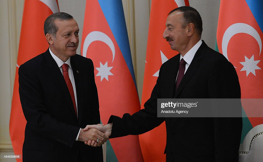 Azerbaijani President Ilham Aliyev (R) shakes hand Turkish President Recep Tayyip Erdogan (L) following a press conference during Erdogan's official visit in the capital city Baku, Azerbiajan on September 3, 2014.