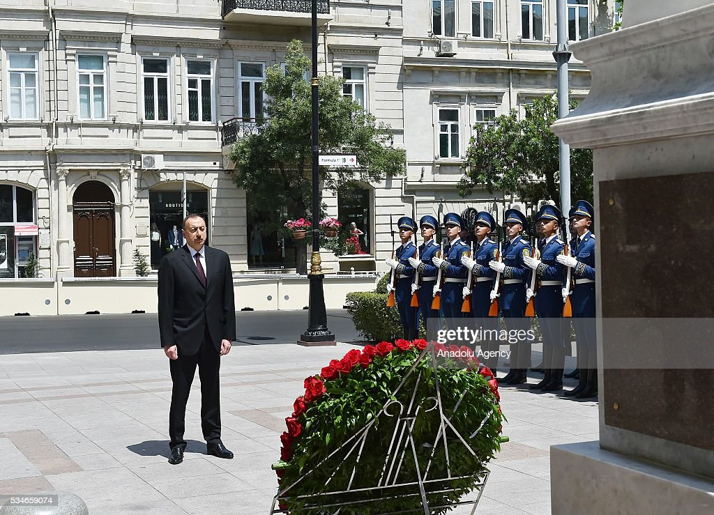 Azerbaijani President Ilham Aliyev stands in silence during the ceremony marking the 98th anniversary of the establishment of the Azerbaijan Democratic Republic (ADR) in Baku, Azerbaijan on May 27, 2016.