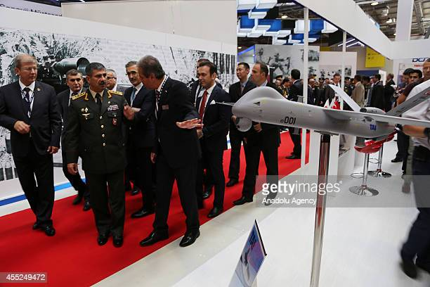 Azerbaijans Defense Minister Zakir Hasanov examines military products during Azerbaijan International Defense Industry Exhibition at the Baku Expo...