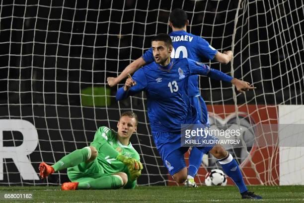 Azerbaijan's Dmitri Nazarov celebrates after scoring a goal during the FIFA World Cup 2018 qualification football match between Azerbaijan and...
