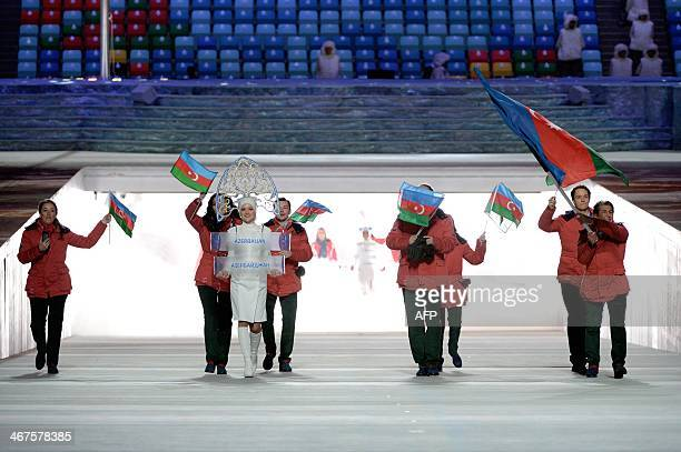 Azerbaijan's flag bearer alpine skier Patrick Brachner leads his delegation during the Opening Ceremony of the Sochi Winter Olympics at the Fisht...