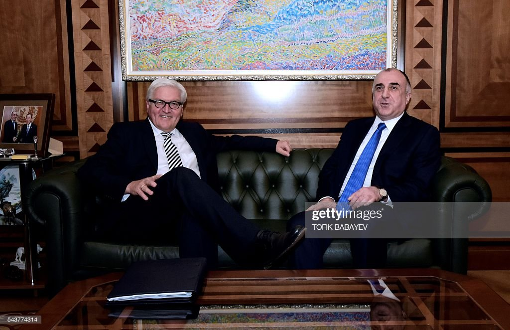 Azerbaijan's Foreign Minister Elmar Mamedyarov (L) speaks with his German counterpart Frank-Walter Steinmeier, who currently chairs the Organisation for Security and Cooperation in Europe (OSCE) monitoring body, during their meeting in Baku on June 30, 2016. / AFP / TOFIK