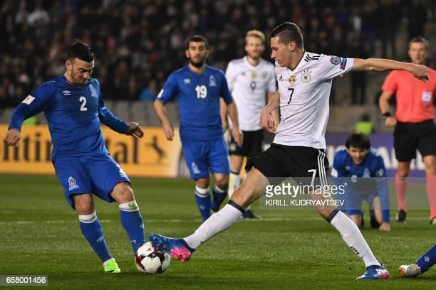Azerbaijan's Gara Garayev and Germany's Julian Draxler vie for the ball during the FIFA World Cup 2018 qualification football match between...