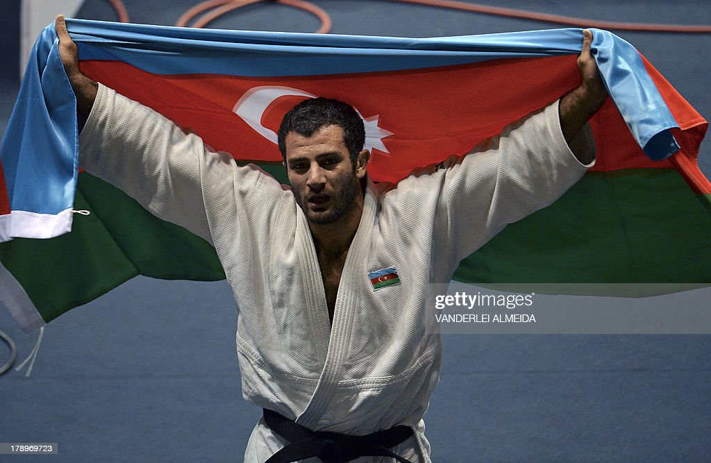 Azerbaijan's judoka Elkhan Mammadov celebrates after defeating Netherlands' Henk Grol during the Men's -100kg category final of the IJF World Judo Championship in Rio de Janeiro, Brazil, on August 31, 2013. AFP PHOTO / VANDERLEI ALMEIDA
