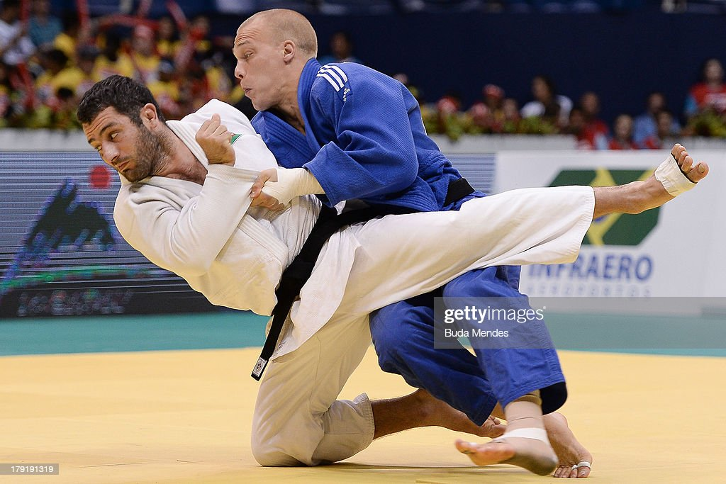 Azerbaijan's judoka <a gi-track='captionPersonalityLinkClicked' href=/galleries/search?phrase=Elkhan+Mammadov&family=editorial&specificpeople=5128460 ng-click='$event.stopPropagation()'>Elkhan Mammadov</a> (white) competes with Netherlands' <a gi-track='captionPersonalityLinkClicked' href=/galleries/search?phrase=Henk+Grol&family=editorial&specificpeople=4920749 ng-click='$event.stopPropagation()'>Henk Grol</a> during the Men's -100kg category final of the IJF World Judo Championship at Gymnasium Maracanazinho on August 31, 2013 in Rio de Janeiro, Brazil.