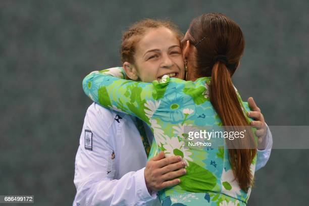 Azerbaijan's Mariya Stadnik receives congratulations and a hug from Azerbaijan's Vice President and First Lady Mehriban Aliyeva after the Women's...