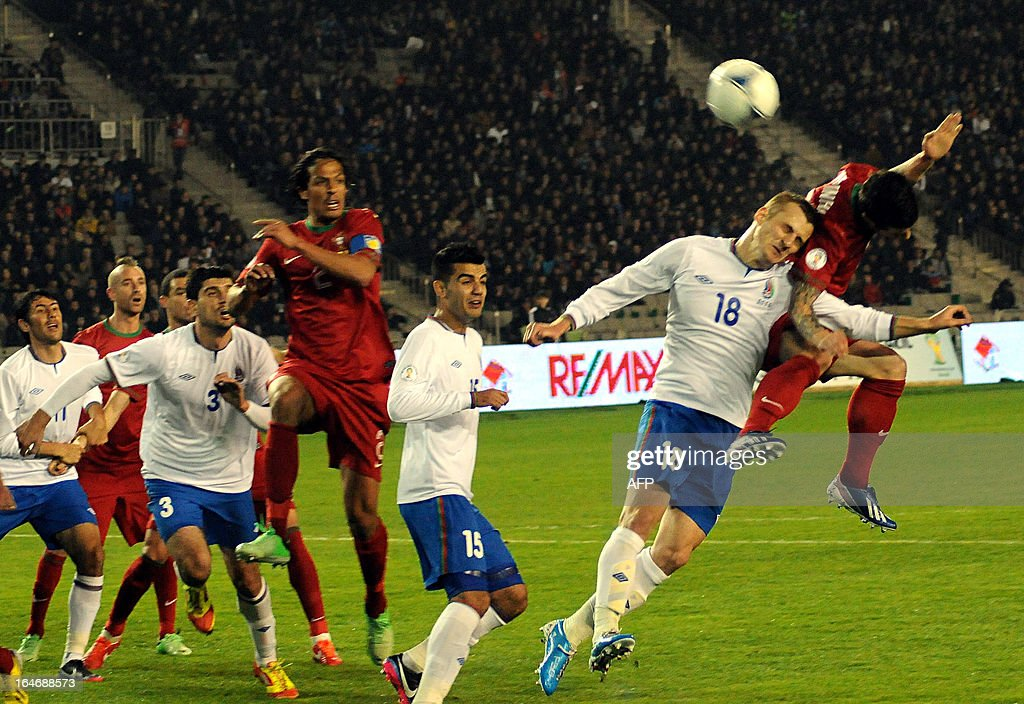 Azerbaijan's national football team defender Maksim Medvedev (2nd R) is in action against Portugal's national football team during their 2014 World Cup qualifying football match at Tofig Bahramov stadium in the Azerbaijan's capital Baku, on March 26, 2013. AFP PHOTO / TOFIK BABAYEV
