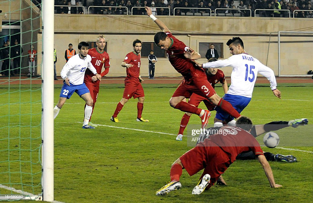Azerbaijan's national football team defender Ruslan Abisov, No. 15, (R) is in action against Portugal's national football team during their 2014 World Cup qualifying football match at Tofig Bahramov stadium in the Azerbaijan's capital Baku, on March 26, 2013. AFP PHOTO / TOFIK BABAYEV