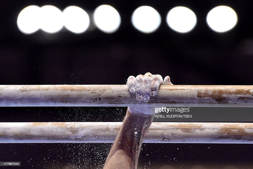 Azerbaijan's Oleq Stepko competes on the parallel bars during the men's final of the artistic gymnastics event at the 2015 European Games in Baku on...