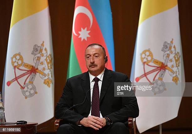 Azerbaijan's President Ilham Aliyev listens to the speach of Pope Francis at the Aliyev congress center during a meeting with the authorities in Baku...