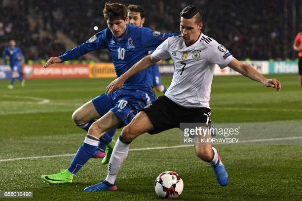 Azerbaijan's Ruslan Gurbanov and Germany's Julian Draxler vie for the ball during the FIFA World Cup 2018 qualification football match between...