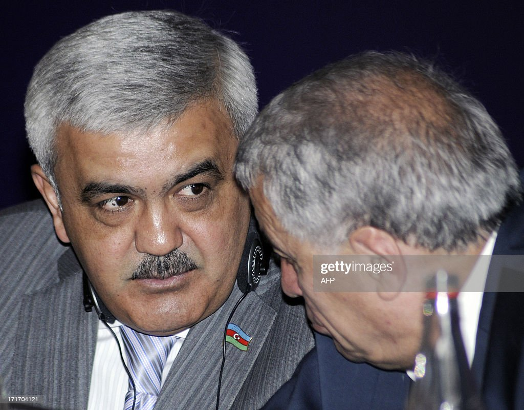 Azerbaijan's State Petrol Company SOCAR's president, Rovnag Abdullayev, (L) confers with Azerbaijani Industry and Energy Minister, Natig Aliyev (R), during a joint press statement of the Shah Deniz II consortium in Baku, the capital of Azerbaijan, on June 28, 2013. The Shah Deniz II consortium of Britain's BP, Azerbaijan's SOCAR, Norway's Statoil and France's Total developing an immense new Azeri gas field, part of European efforts to reduce dependence on Russia, said today it had chosen the shorter, cheaper Trans-Adriatic Pipeline (TAP) over the rival Nabucco project.