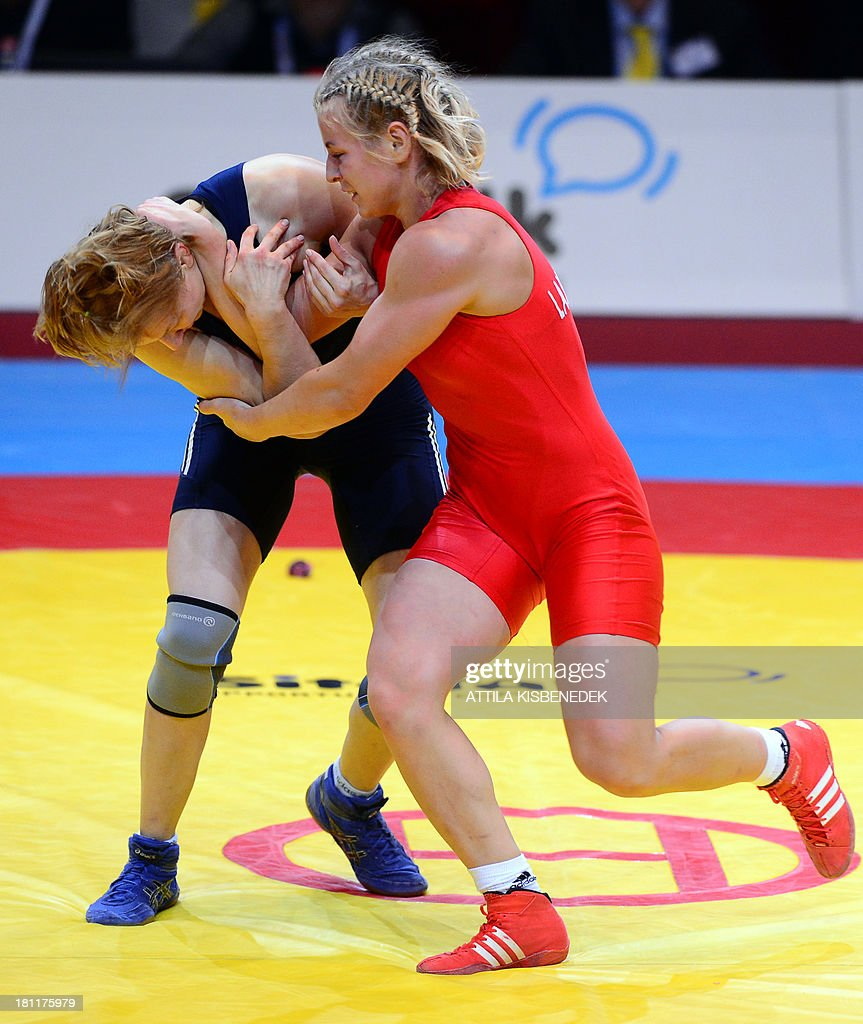 Azerbaijan's Yuliya Ratkevich (blue) and Ukraine's Tetyana Lavrenchuk (red) fight during the women's free style 59 kg category for bronze of the FILA World Wrestling Championships in Budapest on September 19, 2013. Ratkevich won the bronze medal.