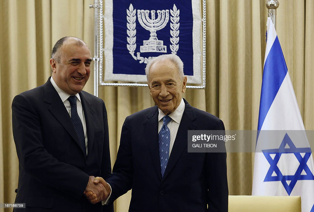 Azeri Foreign Minister Elmar Mammadyarov (L) shakes hands with Israeli President Shimon Peres during a meeting to discuss strenthening strategic relations on April 22, 2013 in Jerusalem.