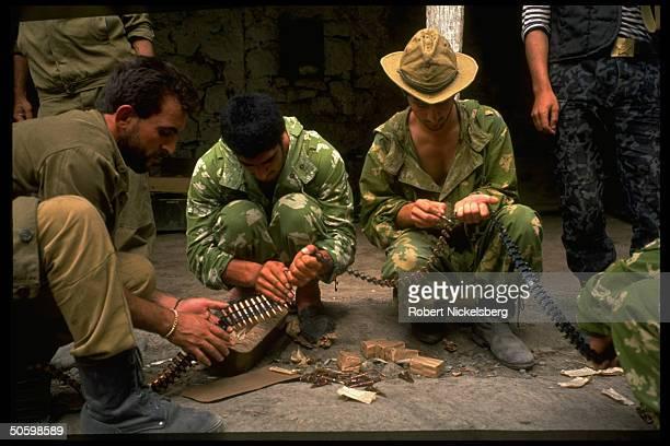 Azeri soldiers loading ammo clips manning frontline NagornoKarabakh border position in Azeri vs Armenian war over Armenian enclave