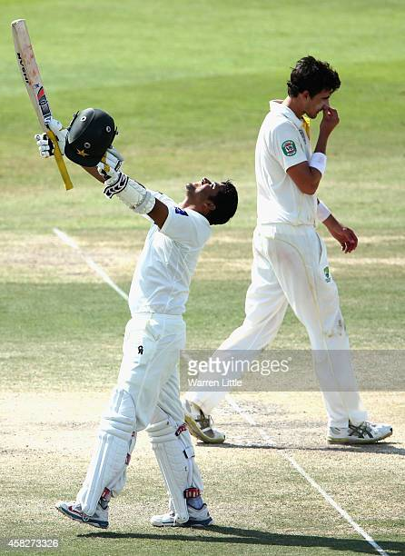Azhar Ali of Pakistan celebrates reaching his century during Day Four of the Second Test between Pakistan and Australia at Sheikh Zayed Stadium on...