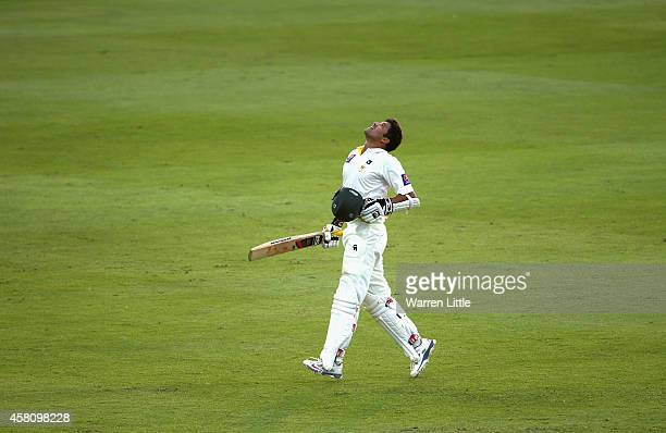 Azhar Ali of Pakistan celebrates reaching his century during day one of the second test between Pakistan and Australia at Sheikh Zayed stadium on...