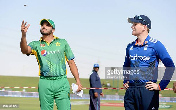 Azhar Ali of Pakistan tosses the coin alongside England captain Eoin Morgan ahead of the 1st One Day International between Pakistan and England at...