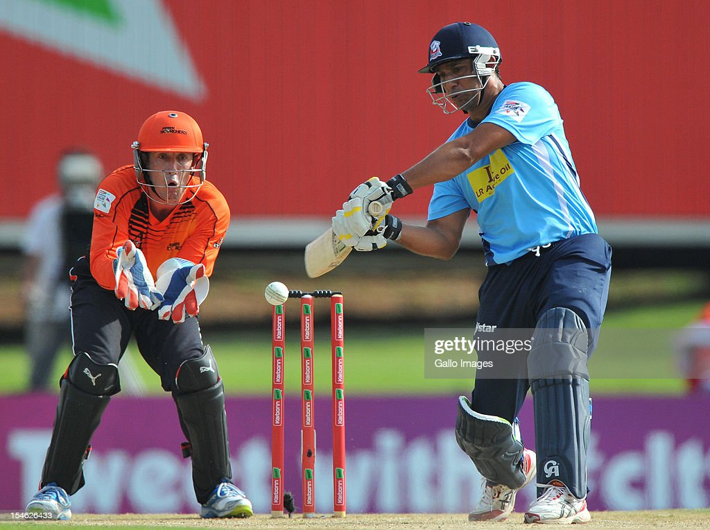 <a gi-track='captionPersonalityLinkClicked' href=/galleries/search?phrase=Azhar+Mahmood&family=editorial&specificpeople=227377 ng-click='$event.stopPropagation()'>Azhar Mahmood</a> of the Aces square-cuts a delivery during the Karbonn Smart CLT20 match between Auckland Aces and Perth Scorchers at SuperSport Park on October 23, 2012 in Pretoria, South Africa.