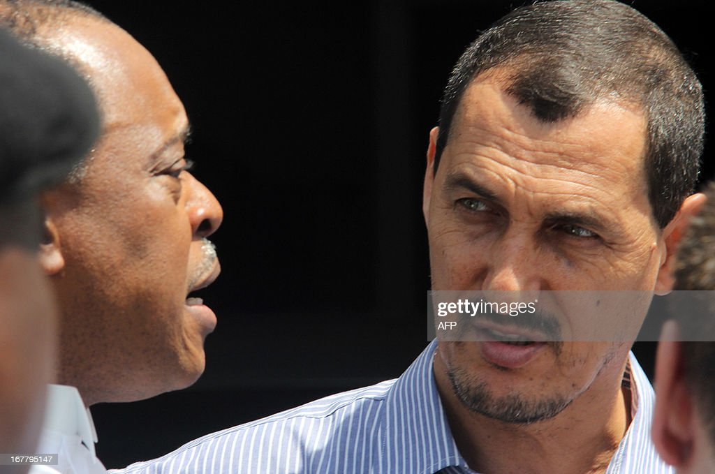 Azim Aghajani (R), an alleged member of the Iranian Revolutionary Guards who is charged with an illegal arms shipment, is pictured on April 30, 2013 outside the Federal High Court in Lagos before the judge postponed his verdict against him. Aghajani, who has been held in detention pending the verdict, was in court alongside his alleged Nigerian co-conspirator. The judge said he needed more time given the complexity of the case, promising a verdict on May 13. The pair were arrested in 2010 after 13 containers of weapons were discovered at the Lagos port of Apapa and have been on trial since February 2011.