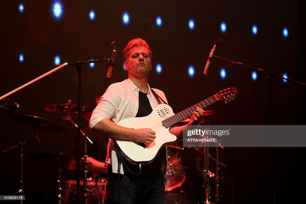 Azim Rouhani, guitarist for Iranian pop singer Mohammad Alizadeh, performs on stage during the 31th Fajr International Music Festival in the capital Tehran, on February 13, 2016. / AFP / ATTA KENARE