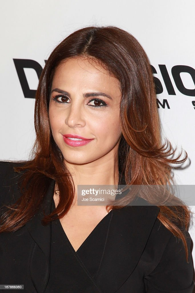 Azita Ghanizada arrives at the 'AFTERSHOCK' premiere presented by Dimension Films and RADiUS-TWC in partnership with Shock Top - Red Carpet on May 1, 2013 in Los Angeles, California.