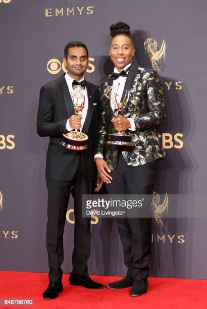 Aziz Ansari and Lena Waithe pose with the award for Outstanding Writing for a Comedy Series for 'Master of None' during the 69th Annual Primetime...