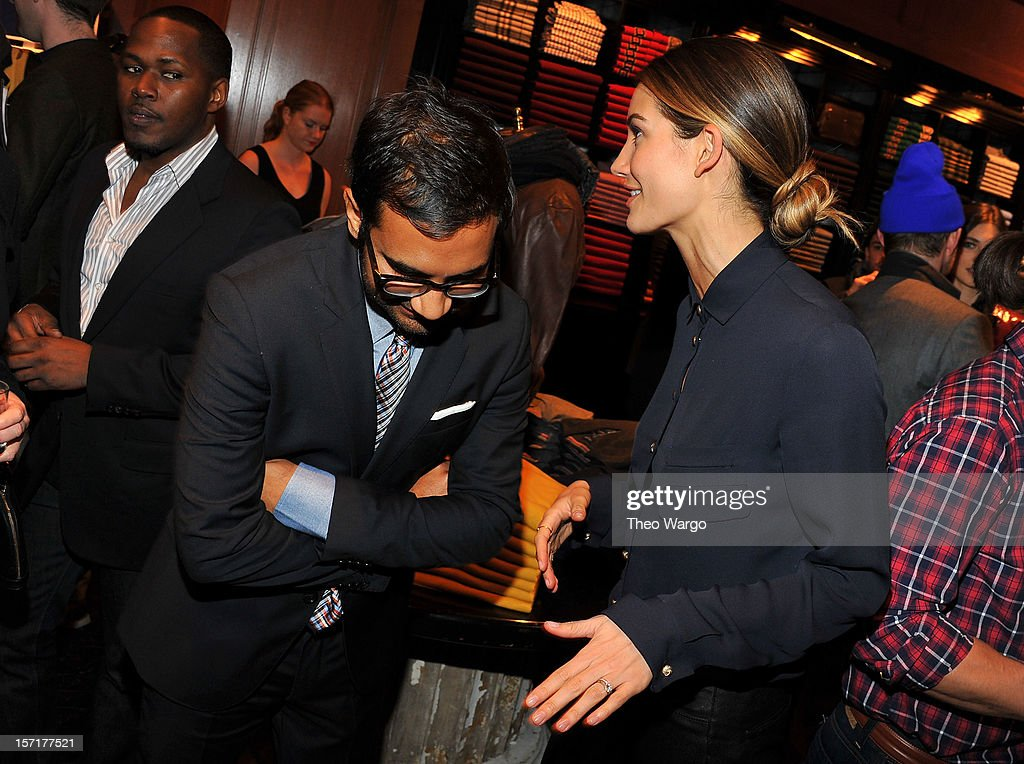 Aziz Ansari and Lily Aldridge attend the Tommy Hilfiger & GQ celebrate Men of New York at the 5th Avenue Flagship on November 29, 2012 in New York City.
