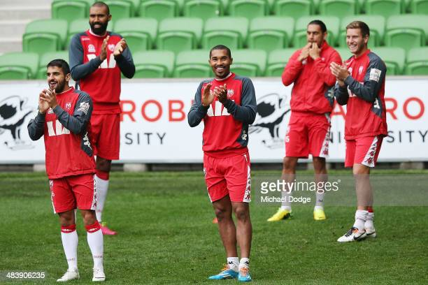 Aziz Behich and Patrick Kisnorbo clap as Harry Kewell comes on to the ground during a Melbourne Heart ALeague training session at AAMI Park on April...