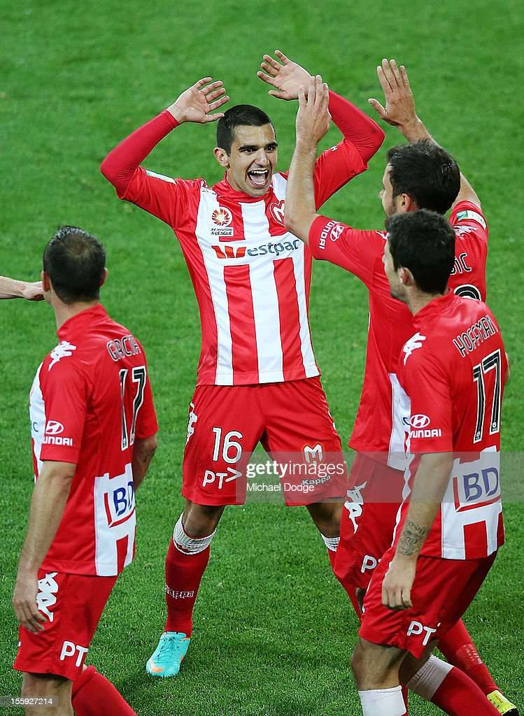 Aziz Behich celebrates a goal by Josip Tadic of Heart during the round six A-League match between the Melbourne Heart and the Brisbane Roar at AAMI Park on November 9, 2012 in Melbourne, Australia.