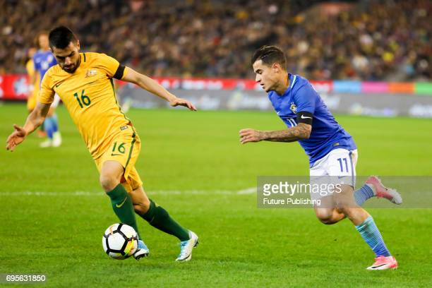 Aziz Behich competes with Philippe Coutinho during play as Brazil plays Australia in the Chevrolet Brasil Global Tour 2017 on June 13 2017 in...