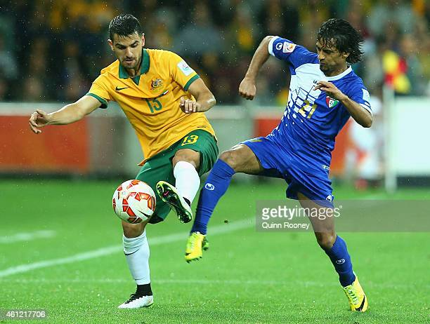 Aziz Behich of Australia and Ali Almaqseed of Kuwait contest for the ball during the 2015 Asian Cup match between the Australian Socceroos and Kuwait...
