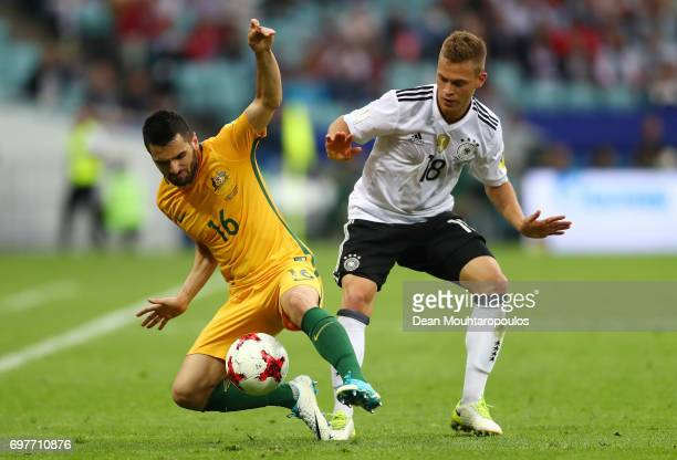 Aziz Behich of Australia and Joshua Kimmich of Germany battle for possession during the FIFA Confederations Cup Russia 2017 Group B match between...