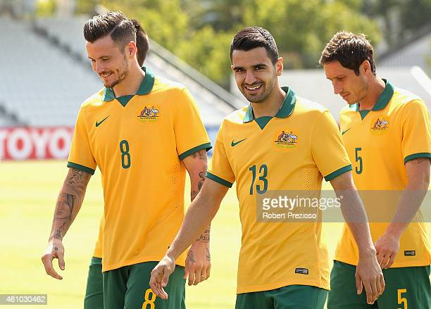 Aziz Behich of Australia arrives for a team photo during an Australian Socceroos team photo session at Lakeside Stadium on January 5 2015 in...