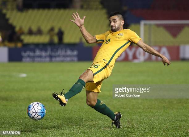 Aziz Behich of Australia attempts to get the ball during the 2018 FIFA World Cup Asian Playoff match between Syria and the Australia Socceroos at...