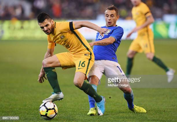 Aziz Behich of Australia competes for the ball against Marcio Souza of Brazil during the Brasil Global Tour match between Australian Socceroos and...