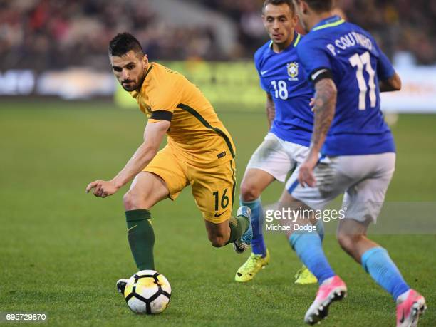 Aziz Behich of Australia competes for the ball during the Brasil Global Tour match between Australian Socceroos and Brazil at Melbourne Cricket...